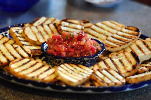 tomato and garlic bruschetta with garlic grilled baguette